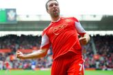 Lambert pleased to equal record